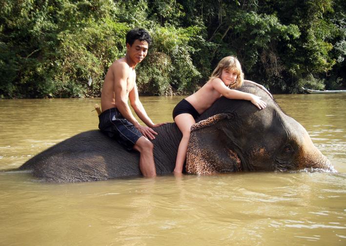 Nude woman riding elephant, nepali aunty